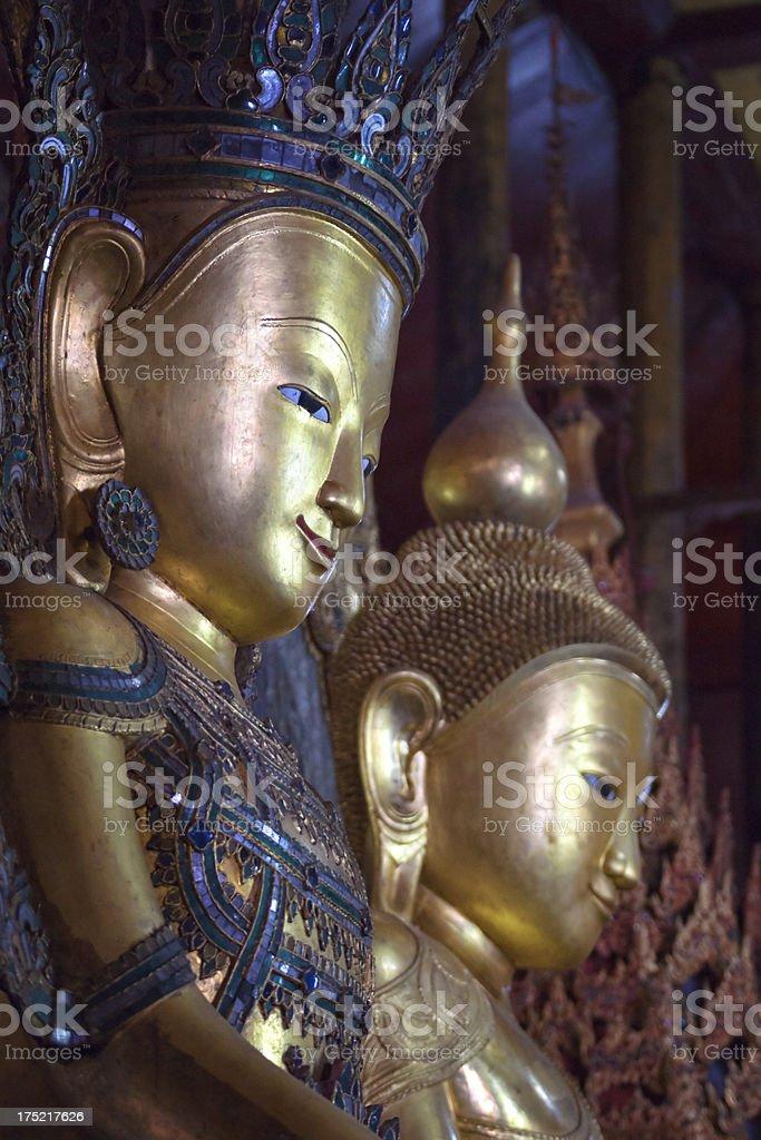 Buddha statues at the Nga Hpe Chaung monastery. stock photo