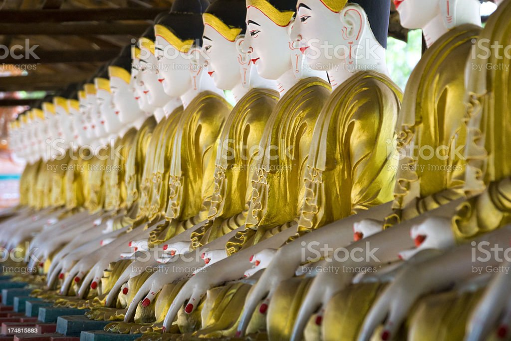 Buddha statues in a row Sagaing, Myanmar. stock photo