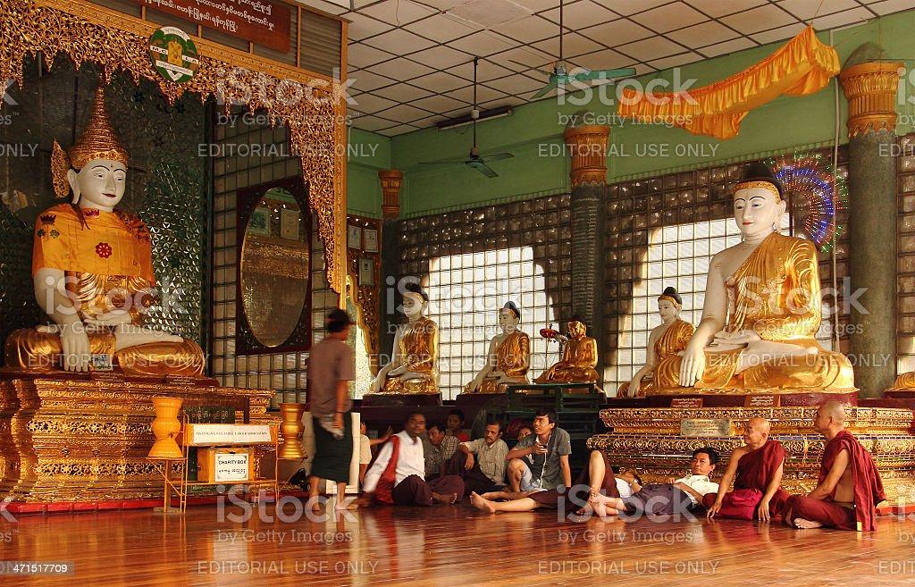 buddha statues monchs and laymen in Shwedagon pagoda_Yangon_ royalty-free stock photo