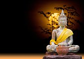 Buddha status of subduing Mara sitting under the moonlight.(abst