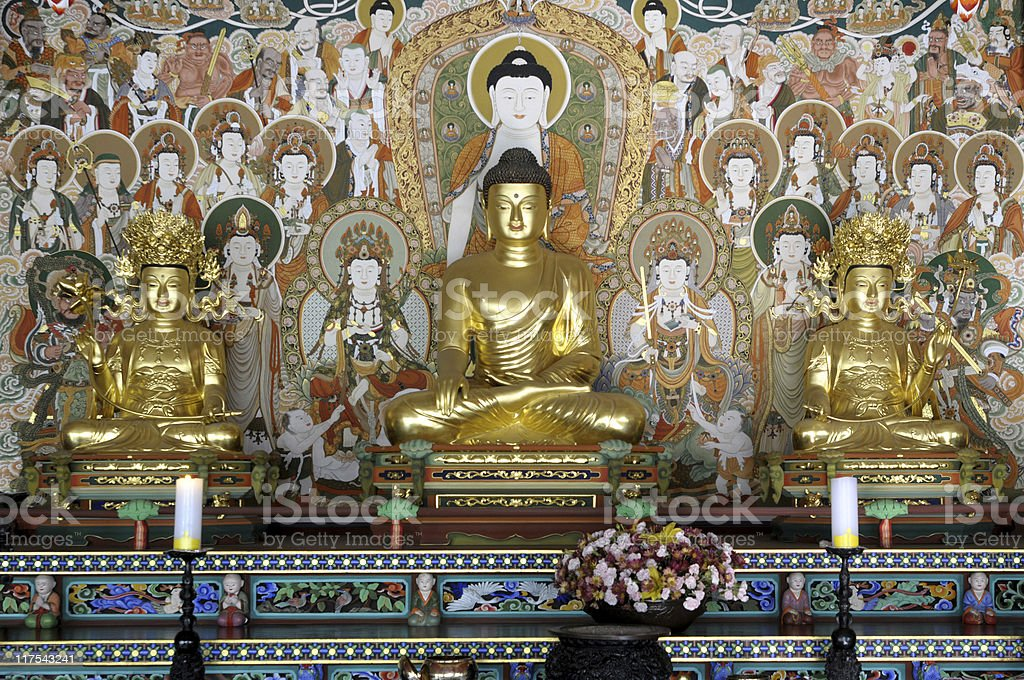 Buddha with disciples and decorative painting stock photo