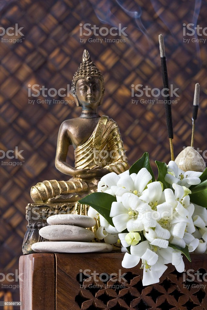 Buddha With Incense Sticks And Flowers royalty-free stock photo