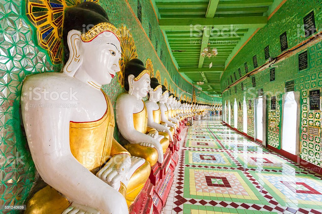 Buddhas and wall in temple, Sagaing hill, Mandalay, Myanmar stock photo