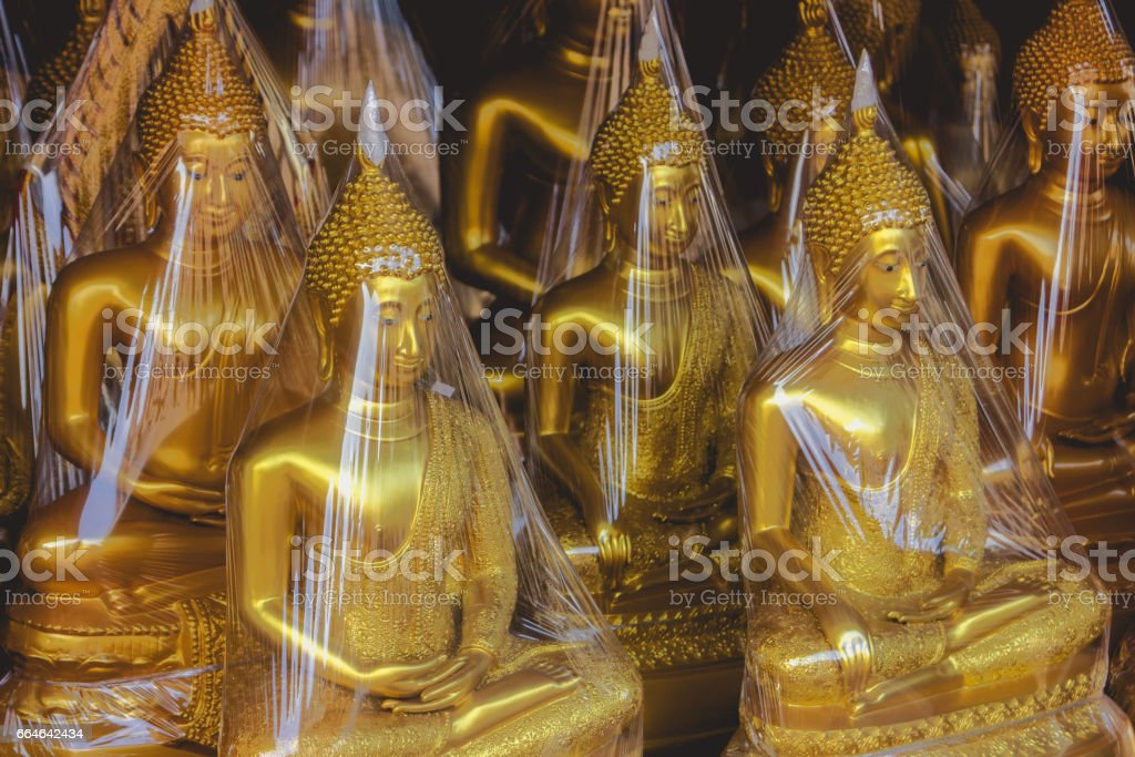 Buddhas are packaged in foil and ready for export. stock photo