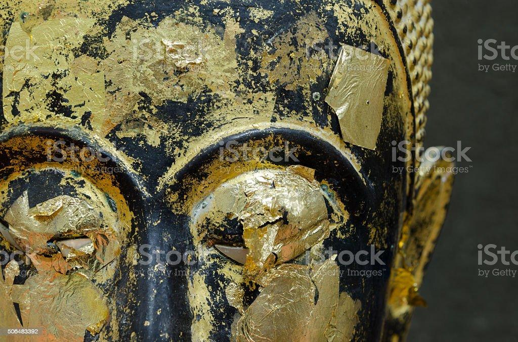 Buddha's face close up focus on eye. stock photo