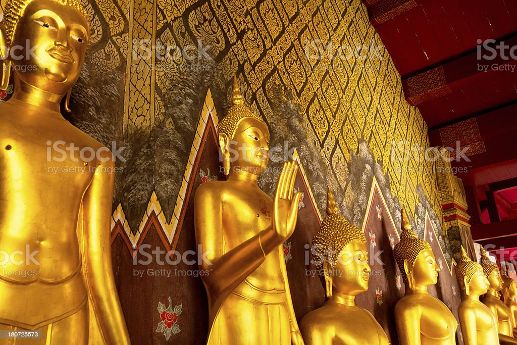 Buddhas in a row stock photo