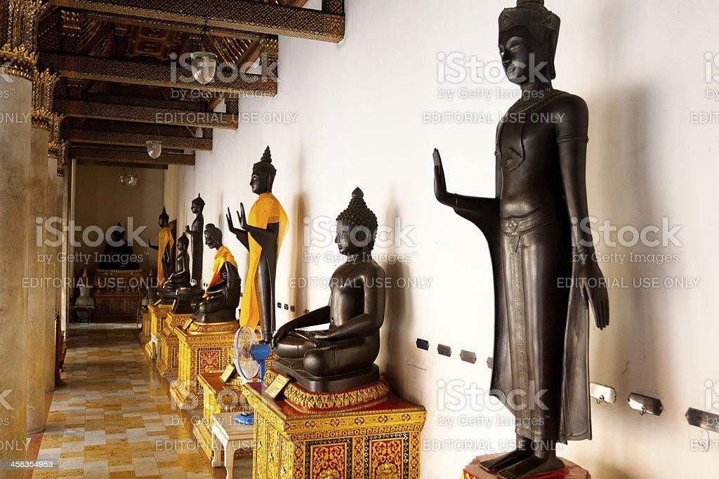 Buddhas in arcade of Wat Benchamabophit stock photo