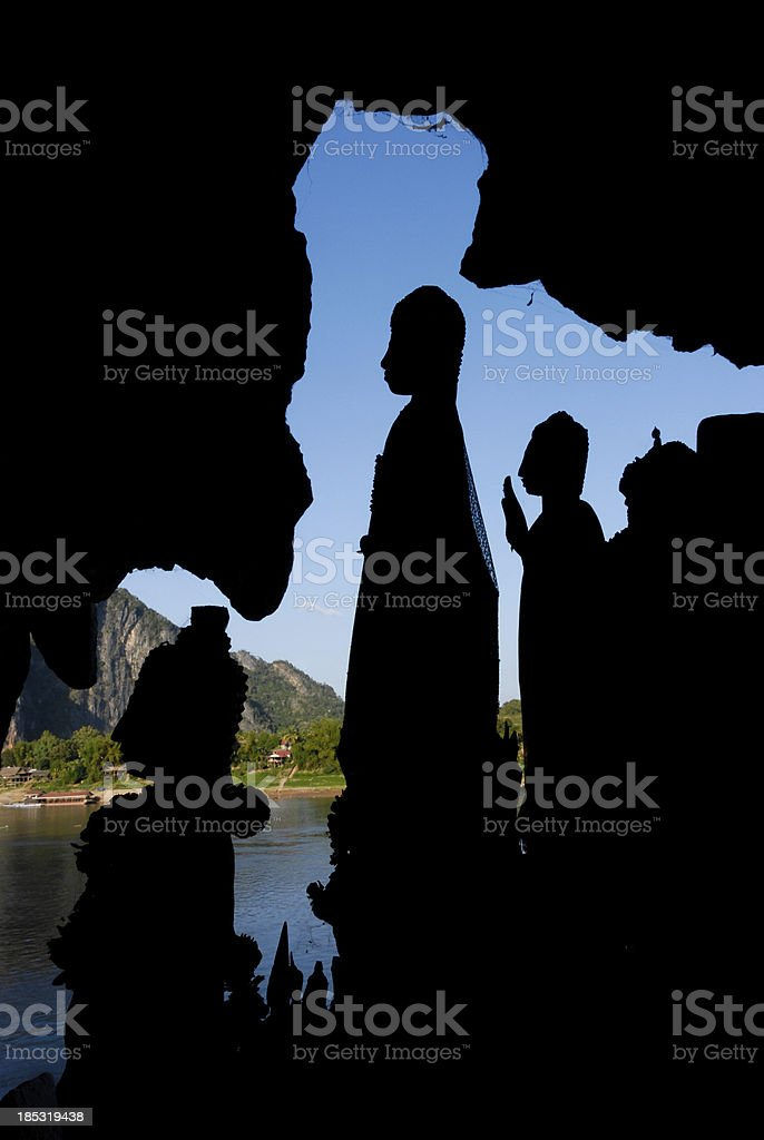 Buddhas in Pak Ou Cave royalty-free stock photo
