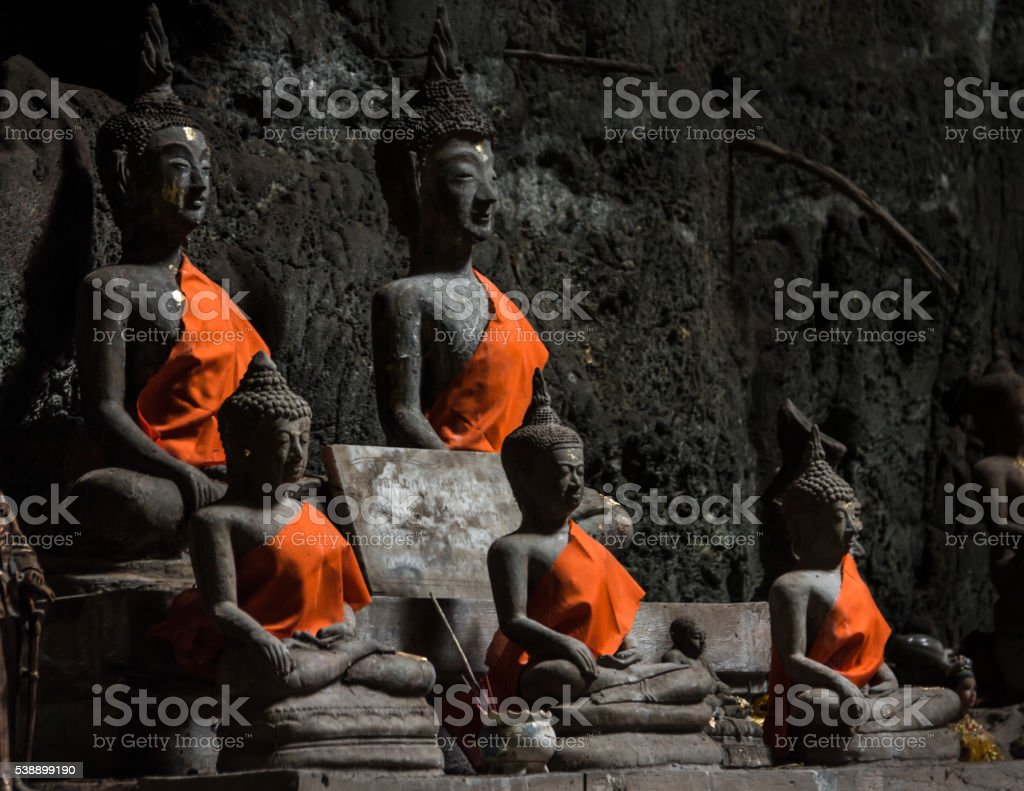 Buddhas in Tham Khao Luang temple stock photo
