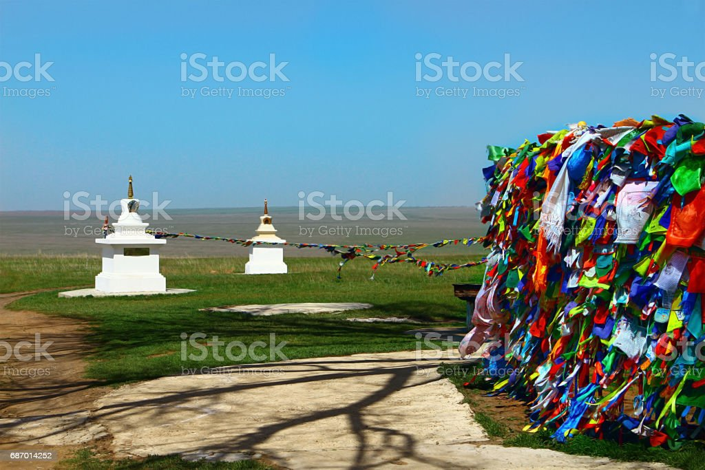 Buddhism prayer flags and stupa in steppe stock photo