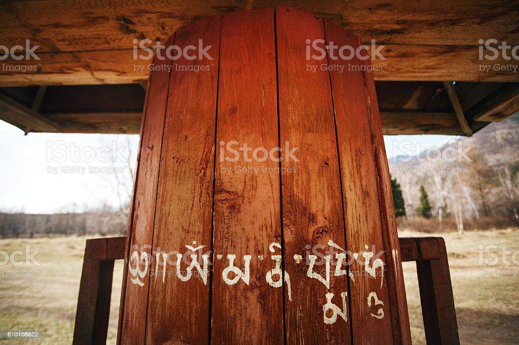 Buddhism prayer wheel in the nature stock photo