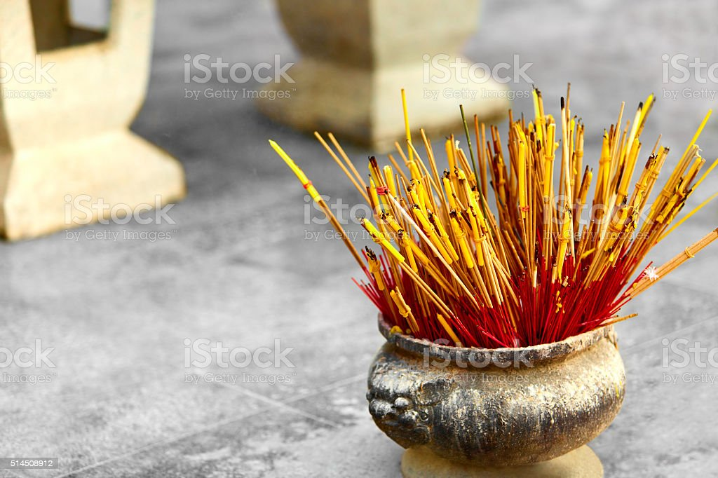 Buddhism, Thailand Religion. Incense Sticks In Urn In Temple. Pray stock photo
