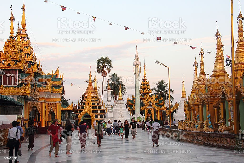 buddhist believers and tourists strolling through Shwedagon pago royalty-free stock photo