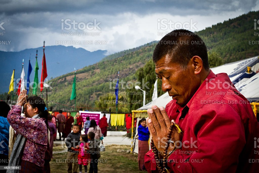 Buddhist devotees prostrating in The Memorial Stupa of Thimphu, Bhutan stock photo