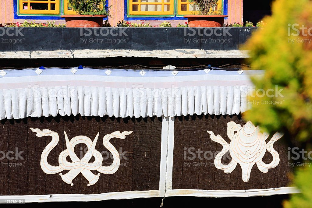 Buddhist endless knot and conch shell. Jokhang temple-Lhasa-Tibet. 1435 stock photo