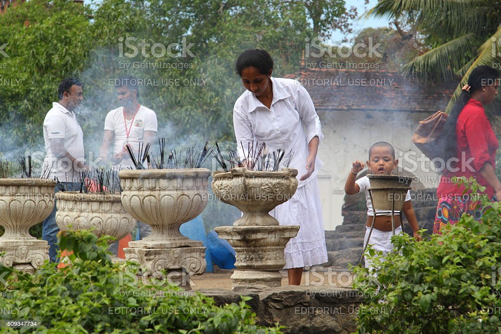 Buddhist family burning incenses stock photo