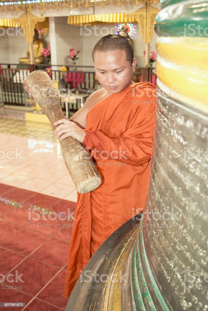 Buddhist hitting the yangon bell in Myanmar stock photo