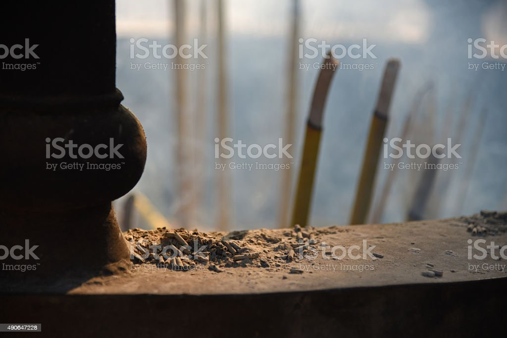 Buddhist incense ashes in a shrine stock photo