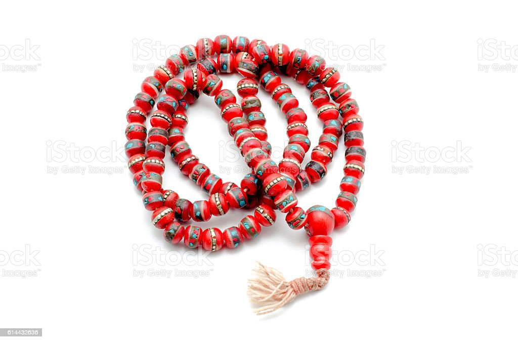 Buddhist Mala Prayer Beads from bone yak. Isolated on white. stock photo