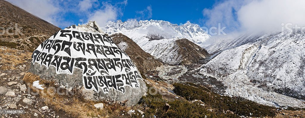 Buddhist mani stone carved mantra Khumbu valley panorama Himalayas Nepal royalty-free stock photo