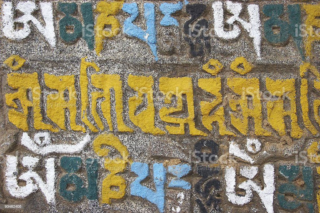 Buddhist mani stone with colorful letters, Nepal royalty-free stock photo