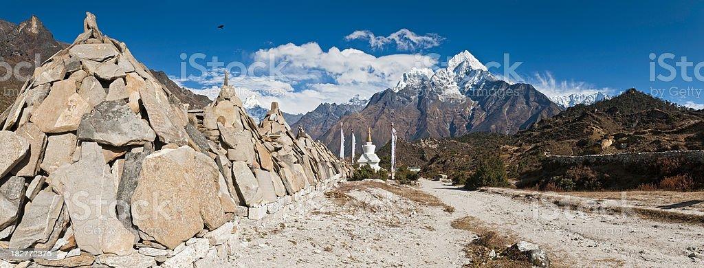 Buddhist mani stones stupa prayer flags Himalaya mountain peaks Nepal royalty-free stock photo