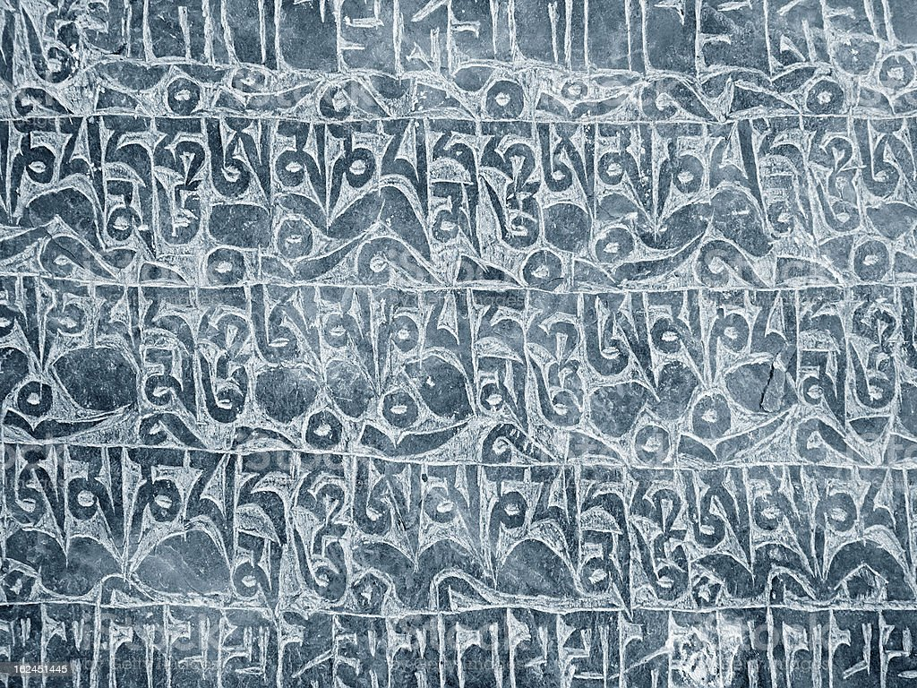 Buddhist mantra carved in stone royalty-free stock photo