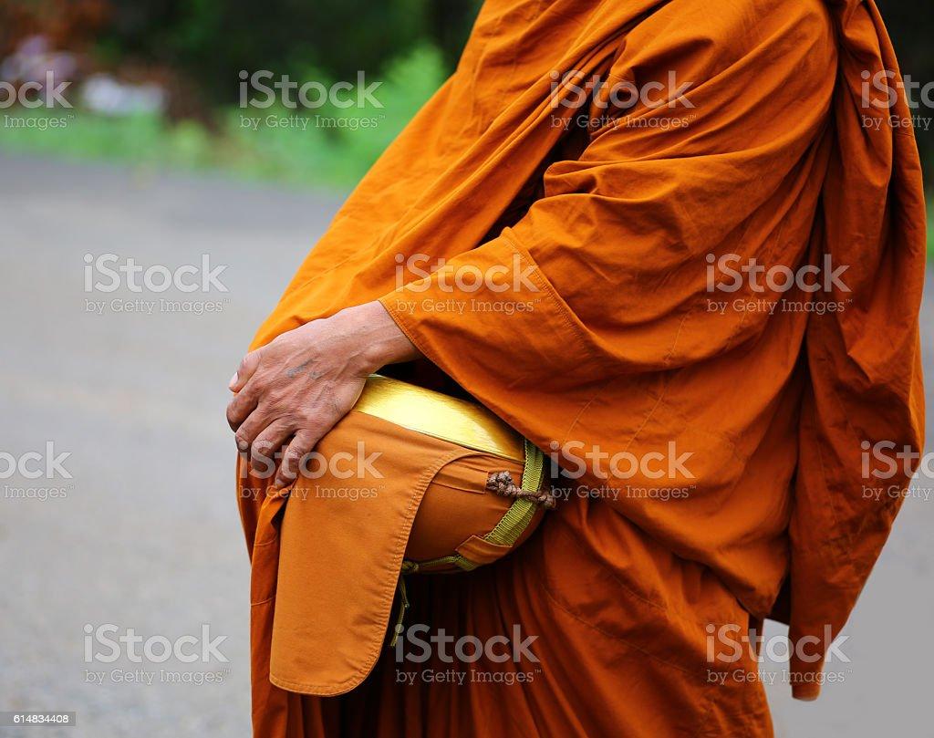 Buddhist merit. monk s alms bowl stock photo