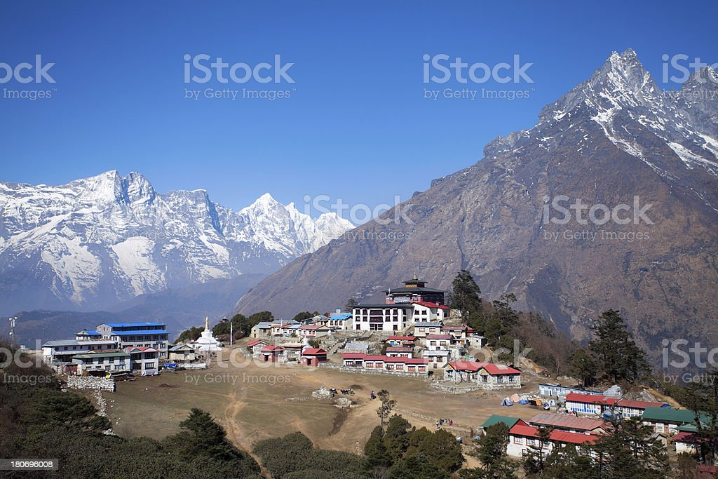 Buddhist monastery Tengboche between the peaks of Himalayas royalty-free stock photo