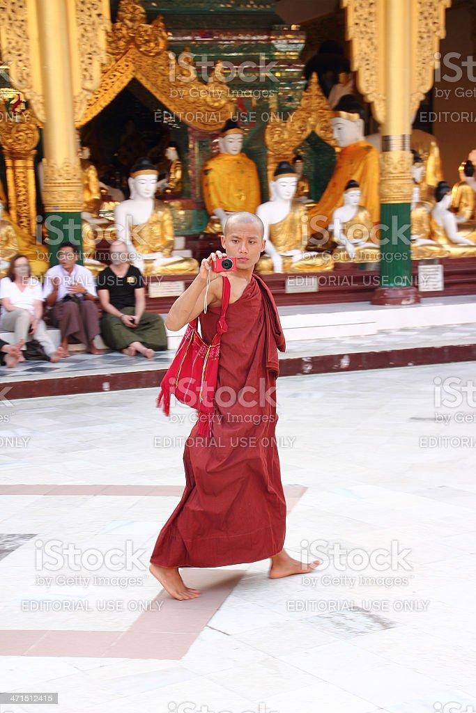 Buddhist monch taking a photograph in Shwedagon pagoda_Yangon royalty-free stock photo