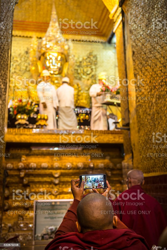 Buddhist monk and Mobile Phone stock photo