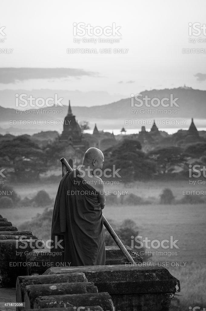 Buddhist monk atop the Shwesandaw Paya in Bagan, Myanmar stock photo