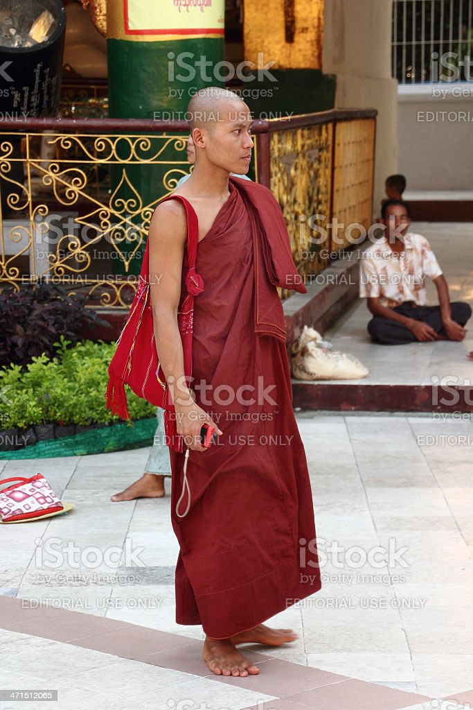 Buddhist monk holding a mobile phone in Shwedagon pagoda_Yangon royalty-free stock photo