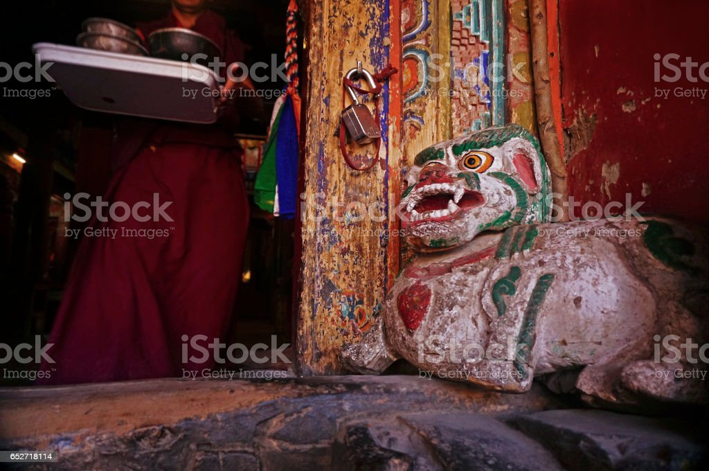 Buddhist Monk in the Ancient Hemis Monastery in Ladakh, India stock photo