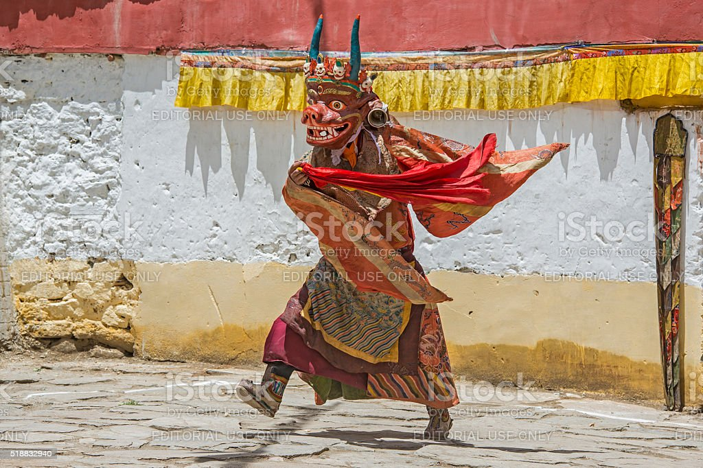 Buddhist monk is performing a sacred dance in Ladakh. stock photo