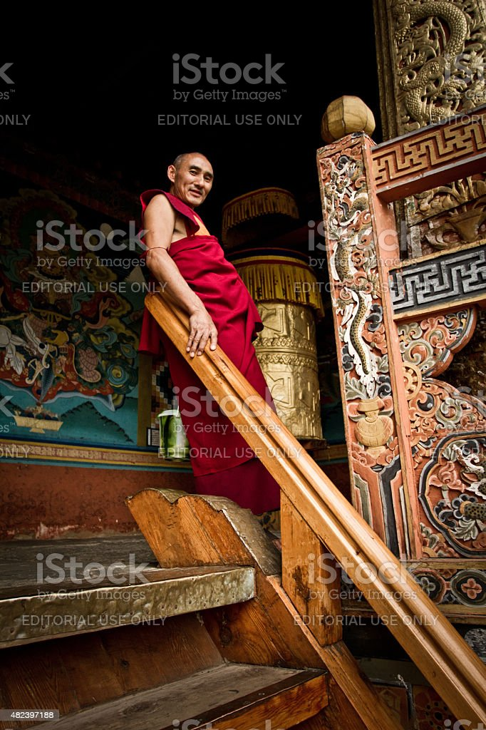 Buddhist monk of the Punakha Fortress Monastery, Paro, Bhutan stock photo