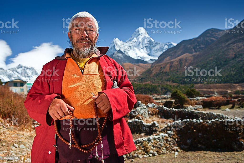 Buddhist monk on the background of Ama Dablam royalty-free stock photo