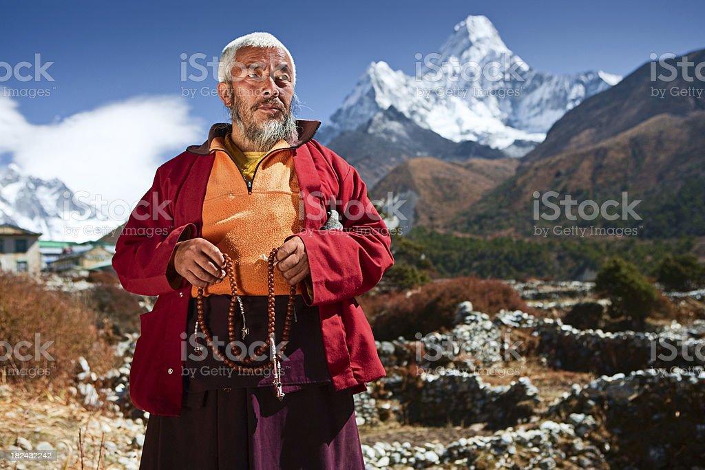 Buddhist monk on the background of Ama Dablam royalty-free stock photo