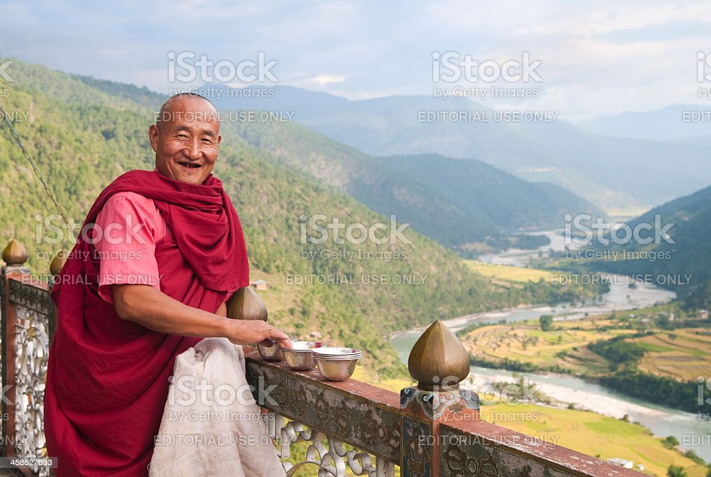 Buddhist Monk Overlooking Paro River Valley royalty-free stock photo