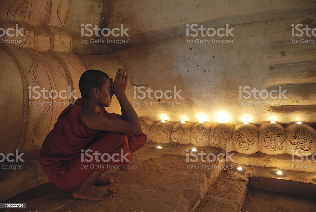 Buddhist monk praying stock photo