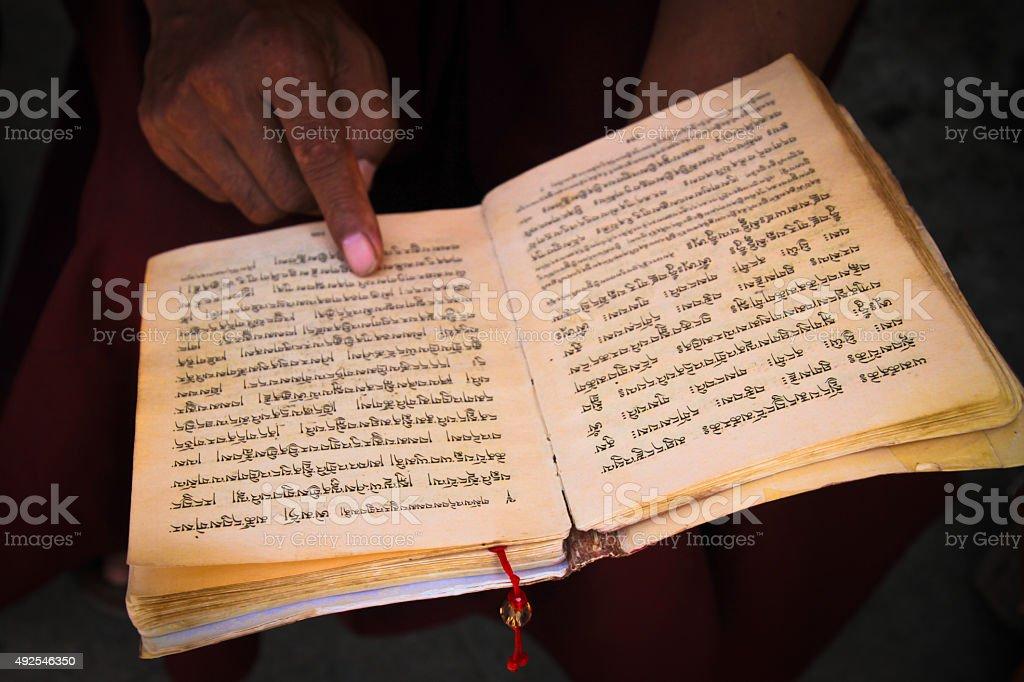 Buddhist monk reads, Kathmandu Nepal stock photo