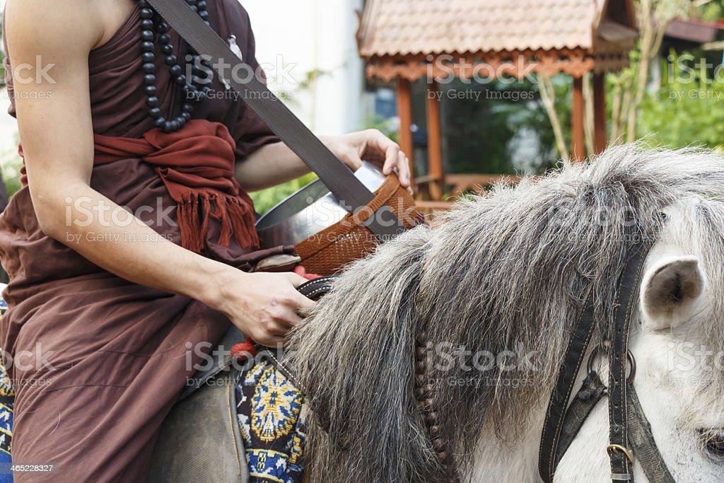 Buddhist monk ride horse stock photo
