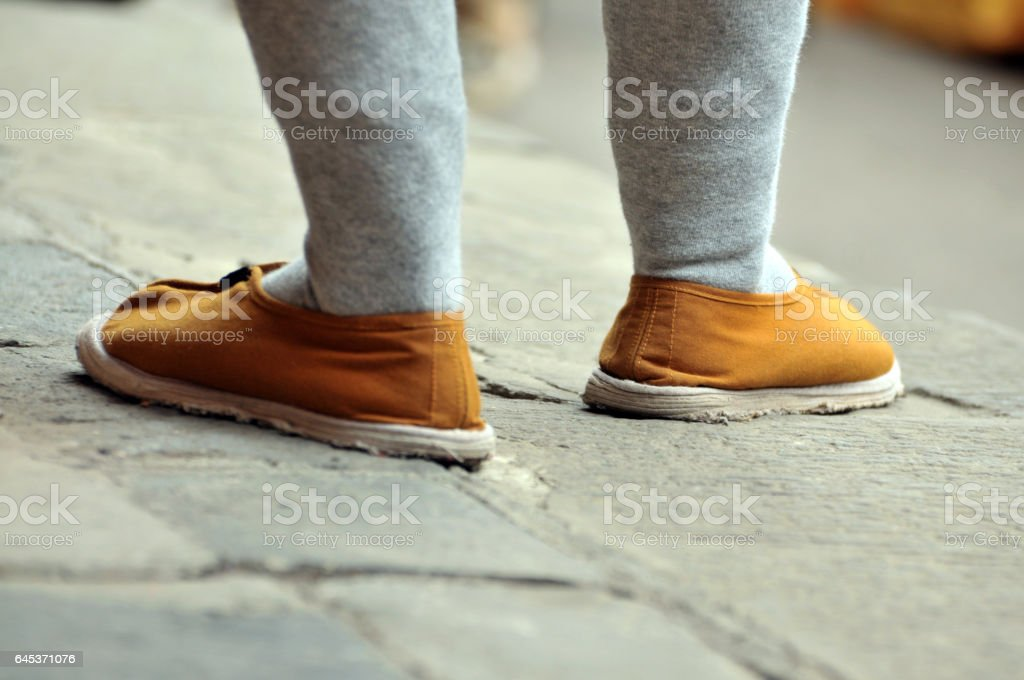 Buddhist monk 's shoes stock photo