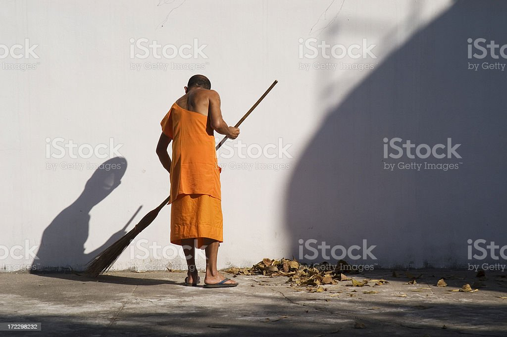 Buddhist Monk Sweeping the Floor royalty-free stock photo