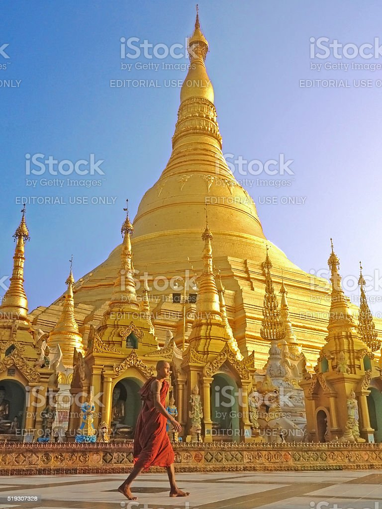 Buddhist monk walking in Shwedagon pagoda stock photo