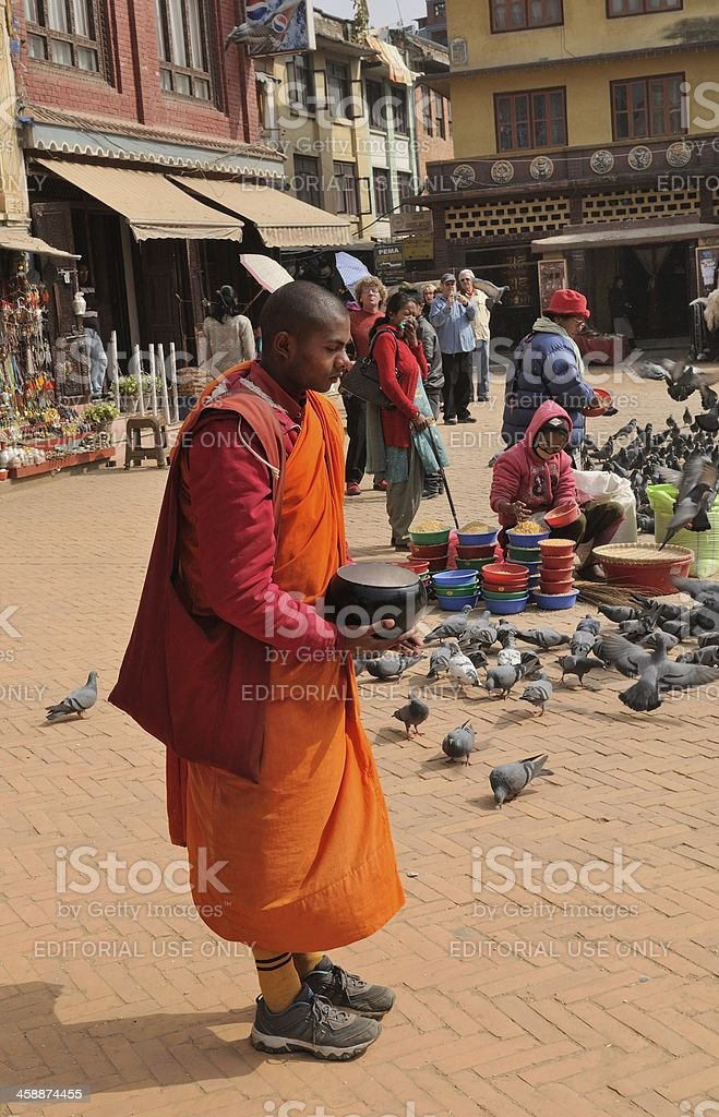 Buddhist monk with alms bowl royalty-free stock photo
