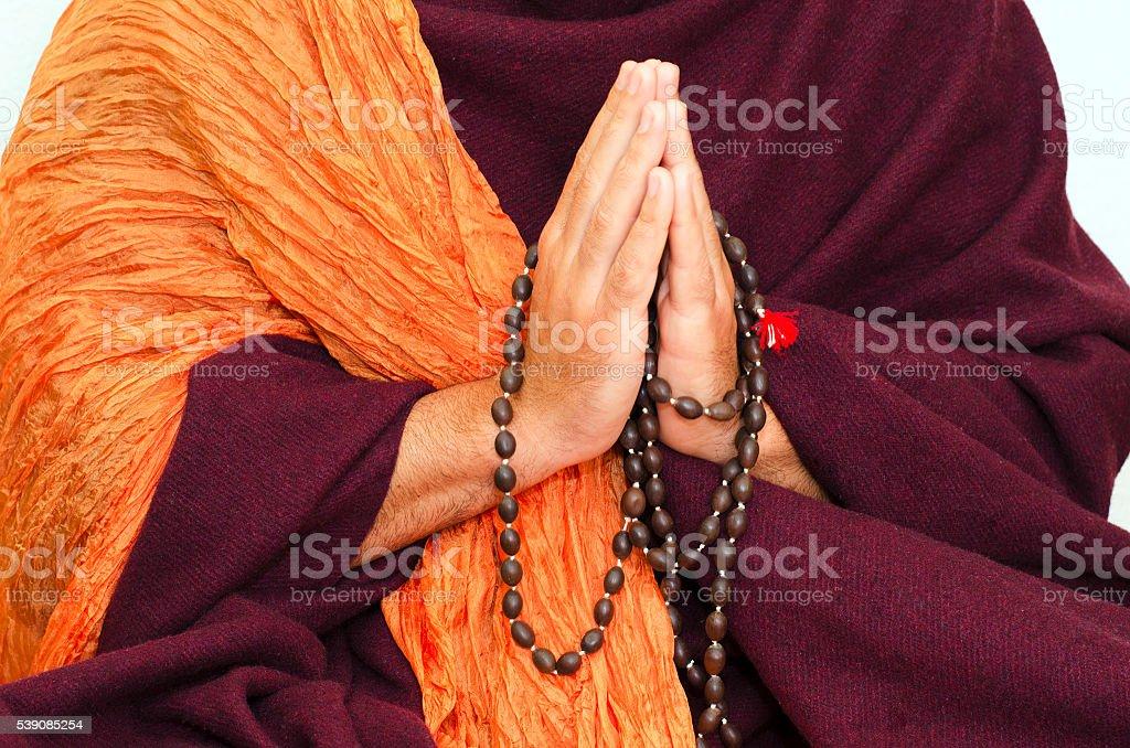 Buddhist Monk with mala beads stock photo