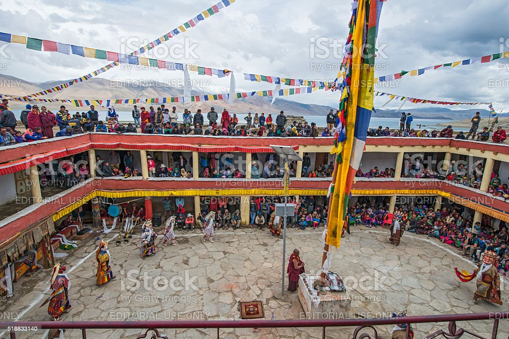 Buddhist monks are performing a sacred dance in Ladakh. stock photo