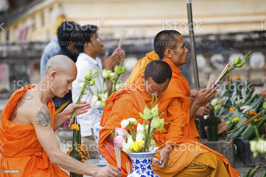 Buddhist monks are praying in front of a temple stock photo