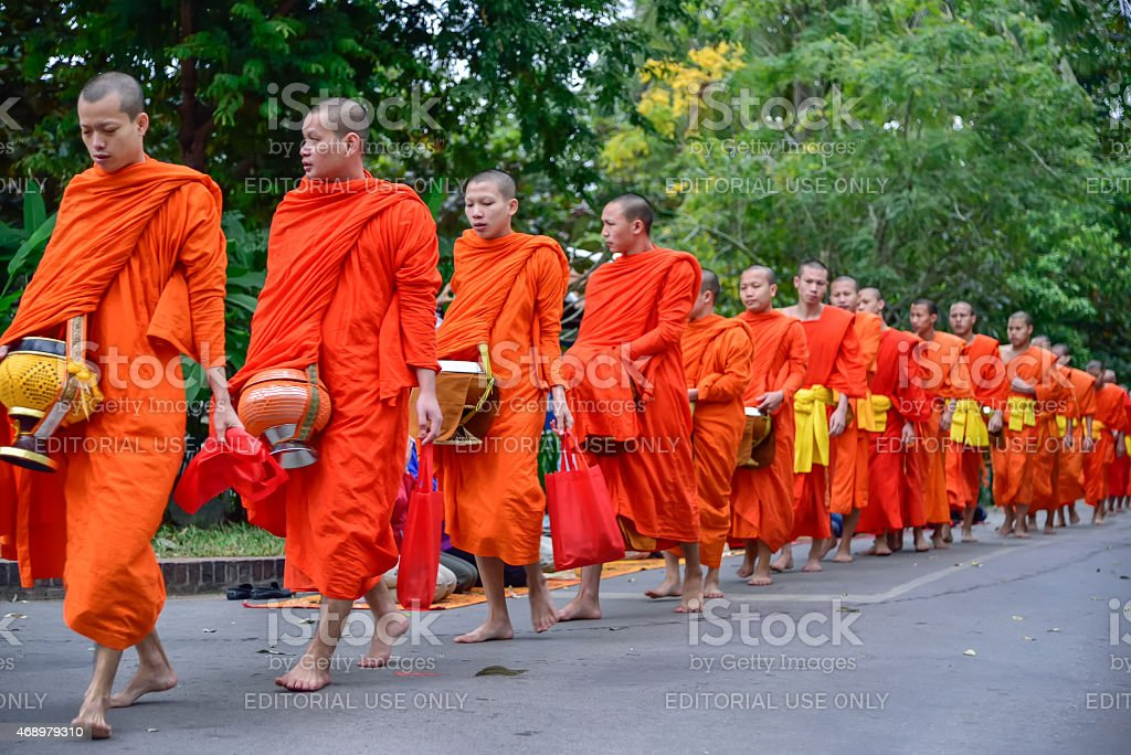 Buddhist monks daily ritual of collecting alms and offerings stock photo